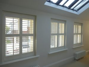 Three Window With White Plantation Shutters