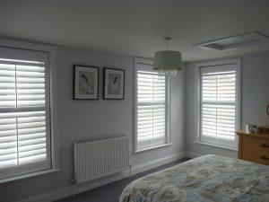 Shutter Blinds Across Three Bedroom Windows