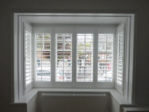 White Plantation Shutters In Square Bay Window