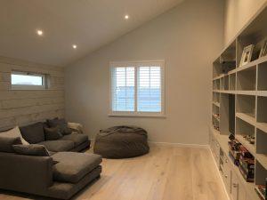 White Shutter Blinds On Square Window In Living Room