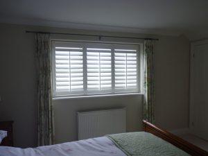 White Plantation Shutters in Bedroom Window
