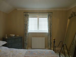 Small Bedroom Window With White Shutters