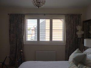 White Window Shutters In The Bedroom