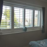 White Window Shutters In Bedroom Window