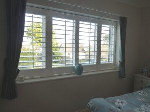 White Window Shutters In Bedroom Window