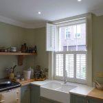 Tier On Tier White Window Shutters In Kitchen With Top Shutters Open