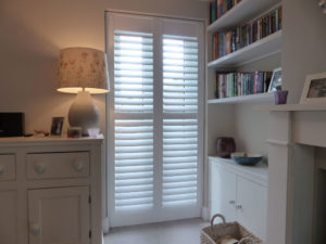 White Plantation Shutters On Patio Doors