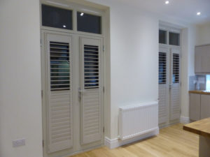 Light Grey Shutters Attached To Inward Opening Doors