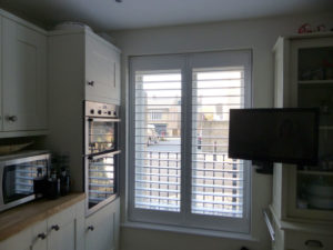 White Shutters On Tall Kitchen Window