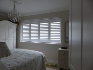 White Louvered Shutters On Bedroom Window