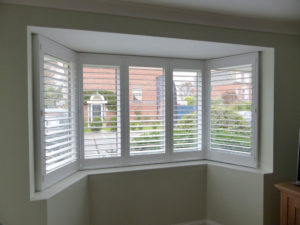 White Shutter Blinds On Angled Bay Window
