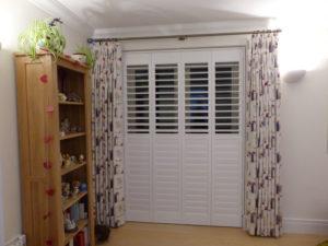 White Plantation Shutters On Bedroom Doors