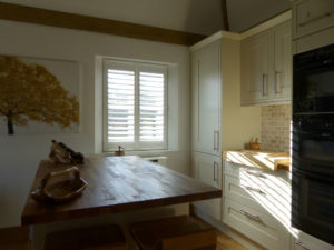 White Window Shutters In Kitchen