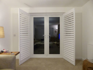 Open Plantation Shutters On French Patio Doors