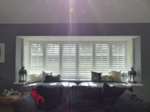 White Window Shutters In Wide Square Bay Window