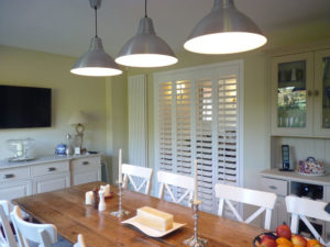 White Shutters Across Internal Door Between Kitchen And Lounge