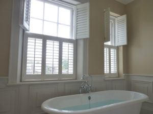 White Top Opening Tier Of Tier Shutters Above Bath