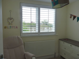 White Shutter Blinds In Girl's Nursery
