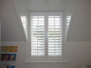 White Shutters In Tall Window